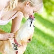 Park: Dog Gives Owner a Kiss — Stock Photo