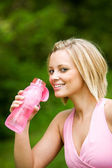 Park: Taking a Drink From a Water Bottle — Stock Photo