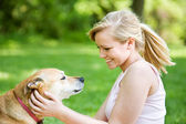 Park: Female Owner Scratches Dog in Ears — Stock Photo