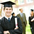 Stock Photo: Graduation: Student Standing With Diploma