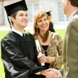 Graduation: Teacher Congratulates New Graduate — Stock Photo #24574671