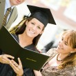 Stock Photo: Graduation: Proud Daughter With Diplomand Parents