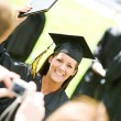 Stock Photo: Graduation: Girl Poses for Picture for Dad