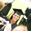 Royalty-Free Stock Photo: Graduation: Girl Poses for Picture for Dad