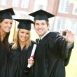 Stock Photo: Graduation: Group of Friends Smile for Camera