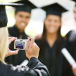Graduation: Girl Takes Photo of Friends — Stock Photo