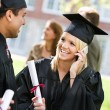 Stock Photo: Graduation: Talking on the Phone to a Relative