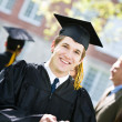 Graduation: Teen Male Texts Friends — Stock Photo