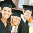 Graduation: Line of Graduates Look to Camera — Stock Photo