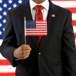 Politician: Holding a United States Flag — Stock Photo