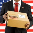Politician: Holding a Cardboard Box to Ship — Stock Photo