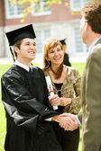 Graduation: Teacher Congratulates New Graduate — Stock Photo