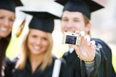 Graduation: Focus on Digital Camera — Stock Photo