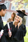 Graduation: Talking on the Phone to a Relative — Stock Photo