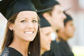 Graduation: Pretty Graduate Looks At Camera — Stock Photo