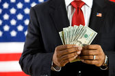 Politician: Holding a Fan of US Currency — Stock Photo