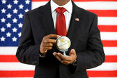Politician: Holding a Globe in His Hands — Stock Photo