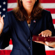 Politician: Woman Taking an Oath on the Bible - Stockfoto