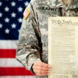 Soldier: Holding United States Constitution — Stock Photo #24778607