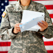 Soldier: Reading a Letter From Home - Stockfoto