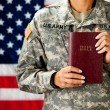 Soldier: Holding a Bible — Stock Photo #24778817