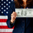 Politician: Holding a Large Hundred Dollar Bill — Stock Photo