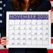 Politician: Holding a Calendar with Election Day - Stock Photo