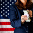 Politician: Counting Stack of Money - Stock Photo