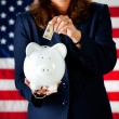 Politician: Putting Money in the Bank - Stock Photo