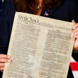 Politician: Holding US Constitution — Stock Photo #24779851