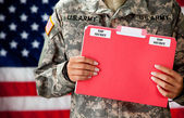 Soldier: Holding Classified Documents — Stock Photo
