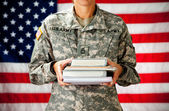 Soldier: Holding Stack of Text Books — Stock Photo