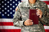 Soldier: Holding a Bible — Stock Photo