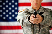 Soldier: Two Hand Grip on Gun — Stock Photo