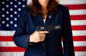 Politician: Holding a .45 Gun — Stock Photo