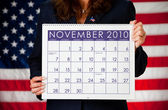 Politician: Holding a Calendar with Election Day — Stock Photo