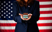 Politician: Holding a Tiny House — Stock Photo