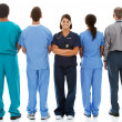 Doctors: Nurse Faces to Camera with Others Turned — Stock Photo