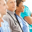 Stock Photo: Doctors: Senior Male Doctor in Line of Physicians