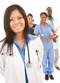 Doctors: Physician in Lab Coat with Others Behind — Stock Photo