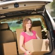 Storage: Getting Box Out of Truck — Stock Photo