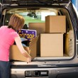 Storage: Woman Packing Away Garage Sale Leftovers — Stockfoto