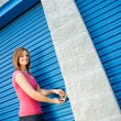 Storage: Woman Putting Lock on Unit Door — Stock Photo