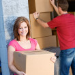 Storage: Woman Resting Against Wall with Box — Stock Photo