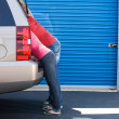 Storage: Man and Woman Leaning into SUV — Stock Photo