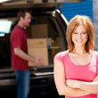 Storage: Woman with Truck Full of Boxes — Stock Photo