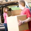 Storage: Man Helping Woman with Boxes — Stock Photo #25016801