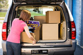 Storage: Woman Packing Away Garage Sale Leftovers — Stock Photo