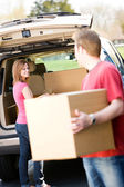 Storage: Man Helping Woman with Boxes — Stock Photo