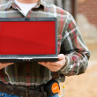 Stock Photo: Construction: Holding Laptop with Blank Screen